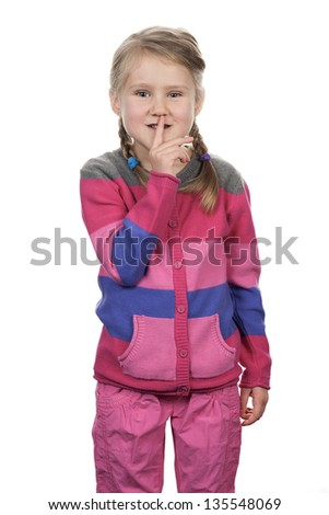 Portrait of cute girl with silence gesture over white background - stock photo