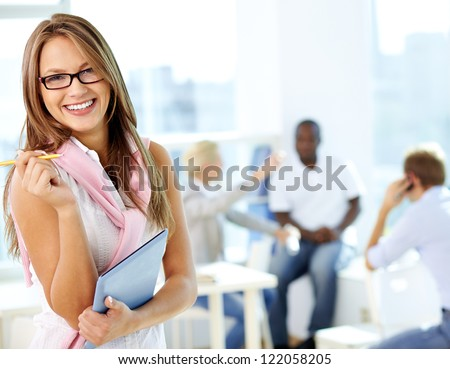 Portrait of cute girl with touchpad looking at camera