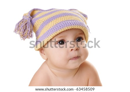 Portrait of cute grimacing baby girl in hat isolated on white background
