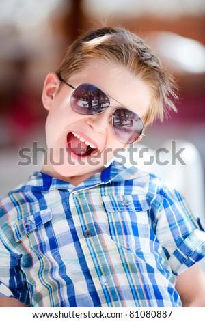 Portrait of cute happy boy in sun glasses - stock photo