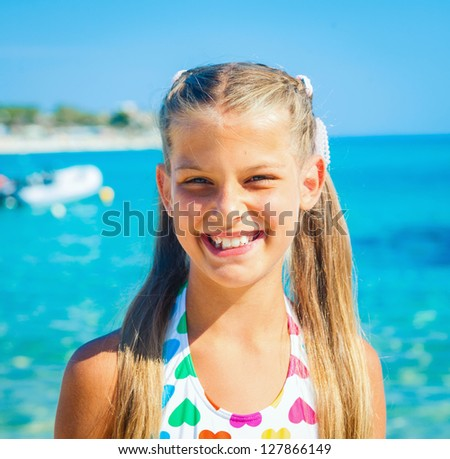 Portrait of cute happy girl on the beach - stock photo