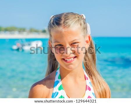 Portrait of cute happy girl on the beach - stock photo