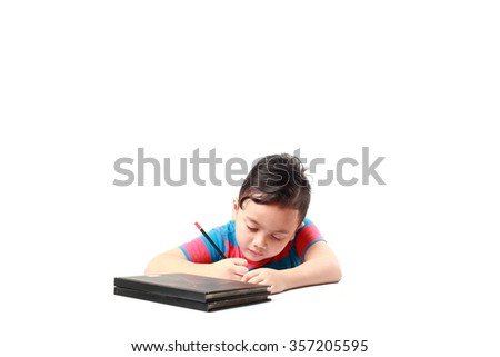 Portrait of cute happy preschool kid boy at home making homework - stock photo