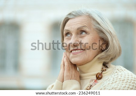Portrait of cute happy senior woman outdoors