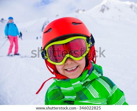 Portrait of Cute happy skier boy in a winter ski resort. - stock photo