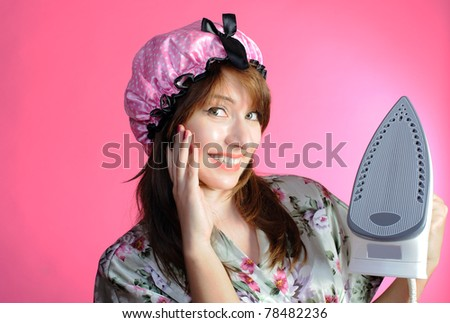Portrait of cute housewife with iron