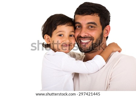 portrait of cute indian boy hugging his father