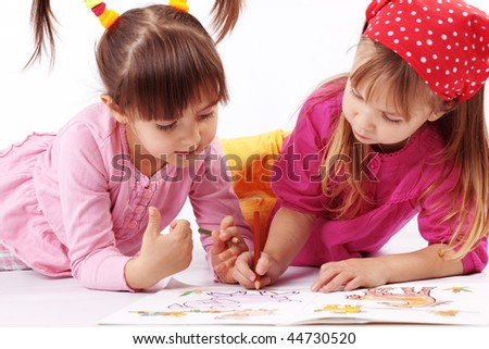 Portrait of cute kids drawing  over white