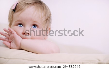 portrait of cute little baby girl, happy family concept
