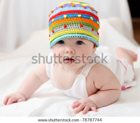 portrait of cute little baby in a funny hat - stock photo