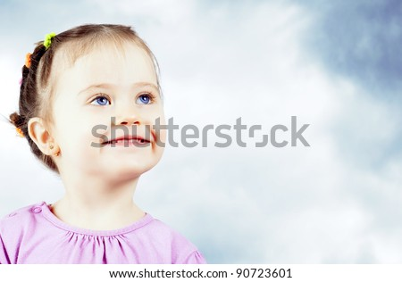 portrait of cute little baby on blue sky background