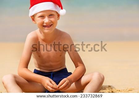 Portrait of cute little boy in Santa hat  - stock photo