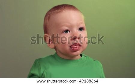 portrait of cute little boy in studio - stock photo