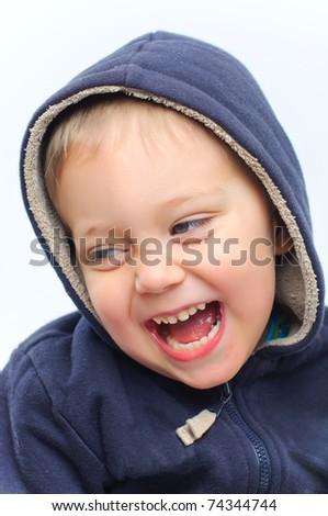 portrait of cute little boy in the hood - stock photo