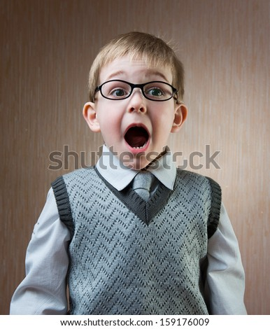Portrait of cute little boy in tie and glasses - stock photo