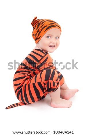 Portrait of cute little boy in tiger costume - stock photo