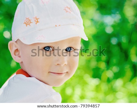 Portrait of cute little boy on natural background - stock photo