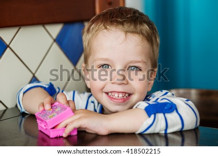 portrait of cute little boy playing with a toy - stock photo