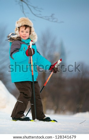 Portrait of cute little boy skiing on cross - stock photo