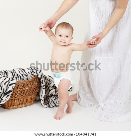 Portrait of cute little boy stand with mother help over white - stock photo