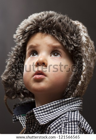 Portrait of cute little boy with warm hat - stock photo