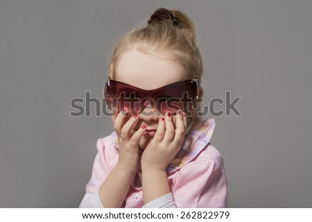 Portrait of Cute Little Caucasian Girl In Sunglasses. Against Gray Background. Horizontal Image - stock photo