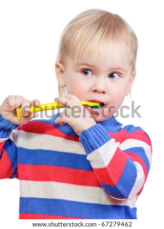 Portrait of cute little girl  brushing teeth on white background - stock photo
