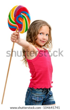 Portrait of cute little girl holding huge candy stick Isolated on white background.