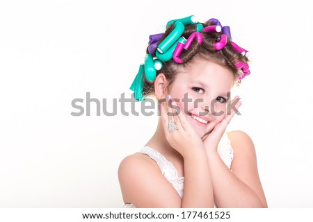 Portrait of Cute little girl in curlers and pajamas, skincare kid beauty and glamour. Funny baby girl with hair curlers. Lovely little girl, Pajamas party. Isolated, studio, white background. series - stock photo