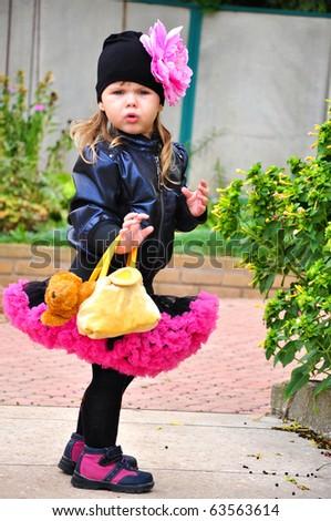 Portrait of cute little girl in pettiskirt outdoors - stock photo