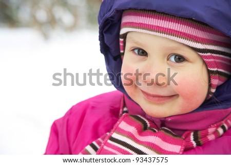 Portrait of cute little girl in winter time - stock photo