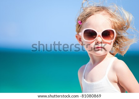 Portrait of cute little girl on beach vacation - stock photo