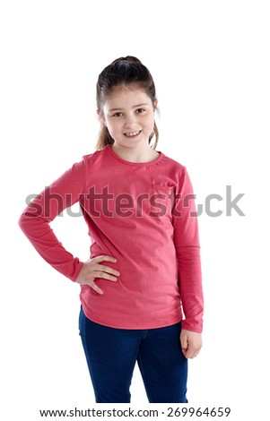 Portrait of cute little girl standing on white background - stock photo