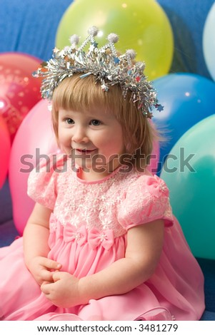 portrait of cute little girl with balloons