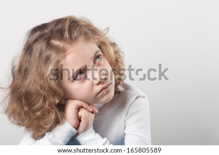 Portrait of cute little girl with dream - stock photo