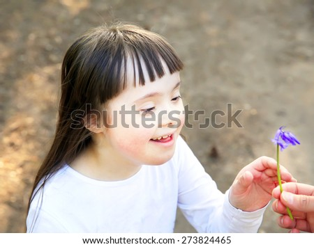 Portrait of cute little girl with flowers - stock photo