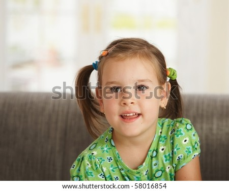 Portrait of cute little girl (3-4 years old) at home smiling.? - stock photo