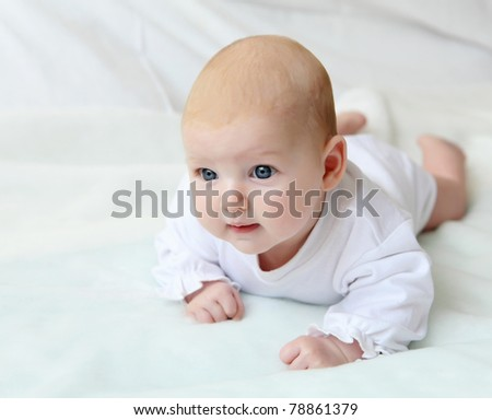 portrait of cute little infant on white - stock photo