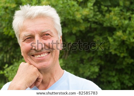 portrait of cute old man at nature