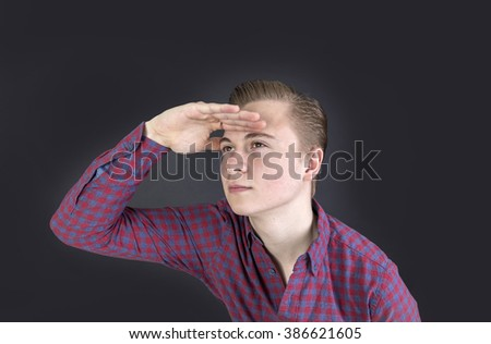 portrait of cute sixteen year old boy in studio  looking into the far