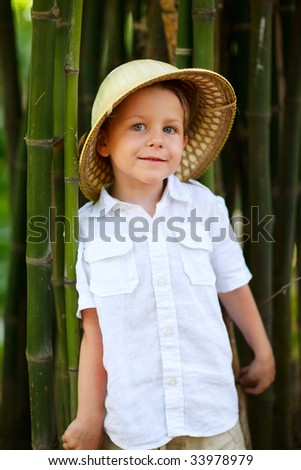 Portrait of cute small boy in safari hat - stock photo