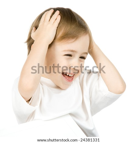 Portrait of cute smiling boy holding hands on head, isolated on white background.