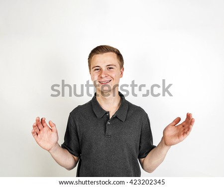 portrait of cute smiling boy posing in studio - stock photo