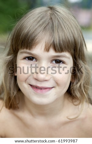 portrait of cute smiling girl nine years old