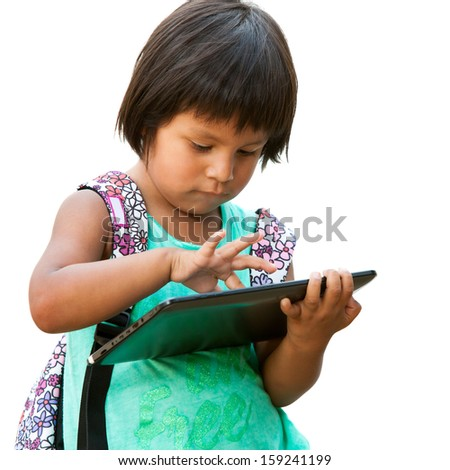 Portrait of cute south american girl typing on tablet.isolated on white background. - stock photo