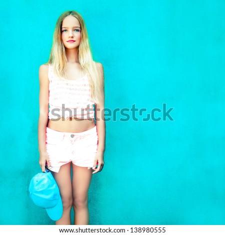 Portrait of cute teen girl in blue wall - stock photo