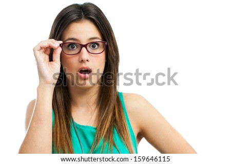 Portrait of cute teen girl with shocking face expression.Isolated on white.  - stock photo