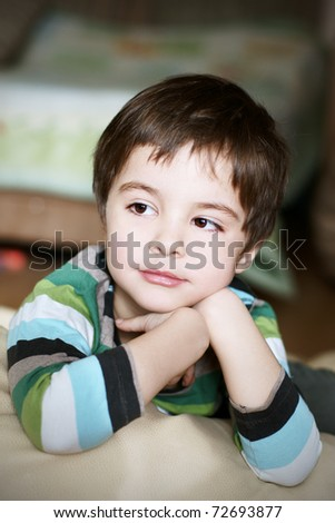 Portrait of cute thoughtful smiling little boy - stock photo