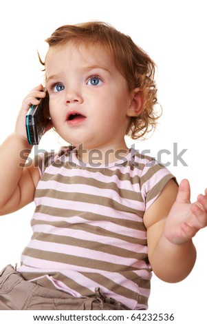 Portrait of cute toddler speaking by cellular phone