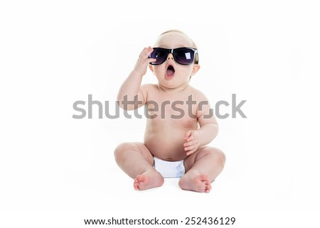 Portrait of cute toddler wearing sunglasses. Isolated on white. - stock photo
